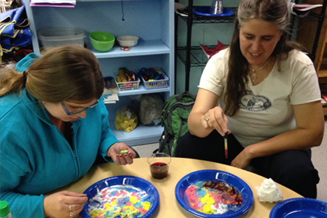 Two student instructors experiment with creative coloring methods.
