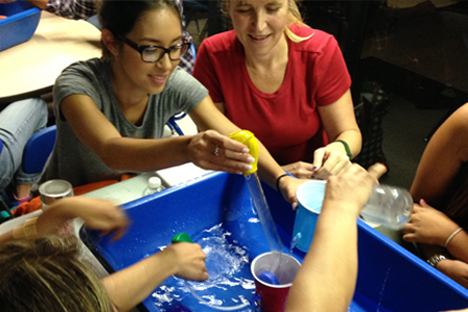 Student instructors participate in open-ended water exploration.
